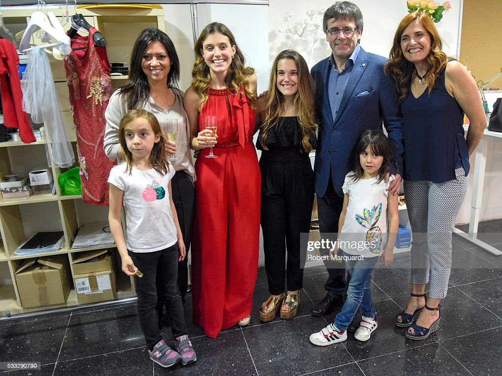 President of Catalunya Carles Puigdemont (3rdR) and Mireia Vidal (3rdL) attend the inauguration of the new store of Mireia Vidal Bridal on May 21, 2016 in Barcelona, Spain.