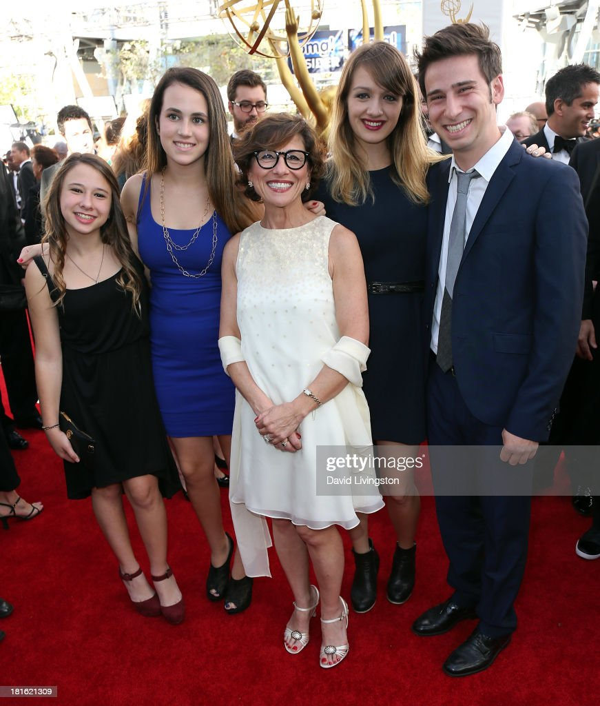 President of CBS Entertainment <a gi-track='captionPersonalityLinkClicked' href=/galleries/search?phrase=Nina+Tassler&family=editorial&specificpeople=213082 ng-click='$event.stopPropagation()'>Nina Tassler</a> (C) and family members attend the 65th Annual Primetime Emmy Awards at the Nokia Theatre L.A. Live on September 22, 2013 in Los Angeles, California.