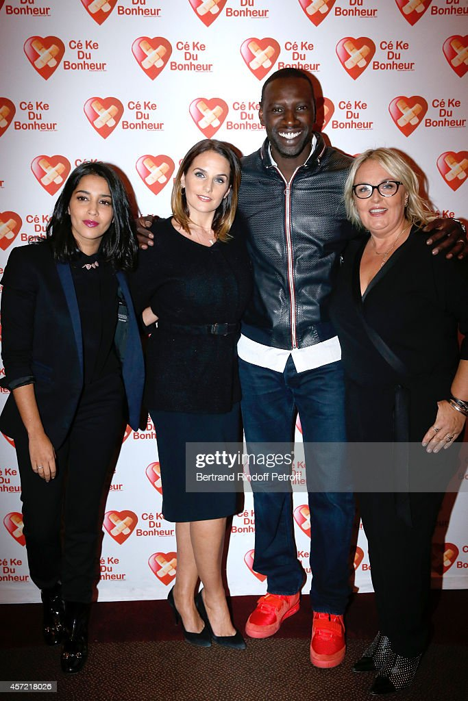 President of 'CekeDuBonheur' Helene Sy and her husband Honorary President of 'CekeDuBonheur' actor <a gi-track='captionPersonalityLinkClicked' href=/galleries/search?phrase=Omar+Sy&family=editorial&specificpeople=4110364 ng-click='$event.stopPropagation()'>Omar Sy</a> standing between godmothers of CKDB <a gi-track='captionPersonalityLinkClicked' href=/galleries/search?phrase=Leila+Bekhti&family=editorial&specificpeople=630989 ng-click='$event.stopPropagation()'>Leila Bekhti</a> (L) and <a gi-track='captionPersonalityLinkClicked' href=/galleries/search?phrase=Valerie+Damidot&family=editorial&specificpeople=5646122 ng-click='$event.stopPropagation()'>Valerie Damidot</a> (R) attend the Samba Premiere to Benefit 'CekeDuBonheur' which celebrates its 10th anniversary. Held at Cinema Gaumont Champs Elysees on October 14, 2014 in Paris, France.