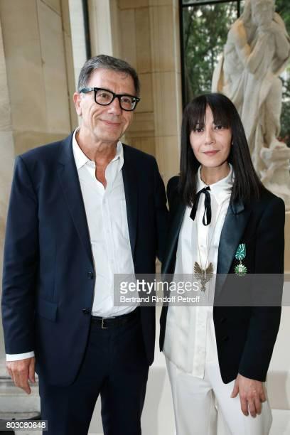 President of Centre Pompidou Serge Lasvignes and Bouchra Jarrar attend Artistic Director of Lanvin Bouchra Jarrar is Decorated 'Officier de l'Ordre...