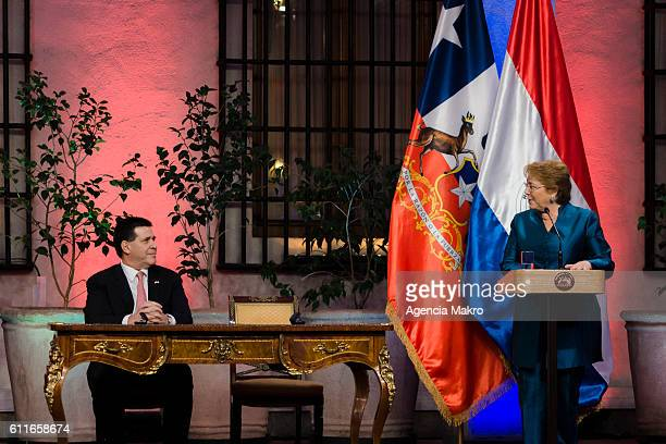President of Chile Michelle Bachelet and President of the Republic of Paraguay Horacio Cartes during a meeting at Patio de Las Camelias of the...