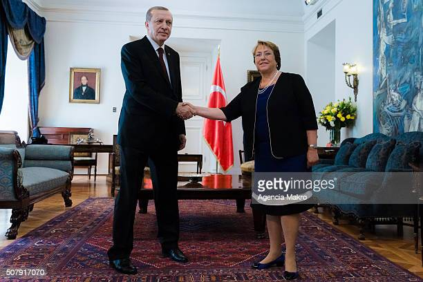 President of Chile Michelle Bachelet and President of Turkey Recep Tayyip Erdogan shake hands at Palacio de La Moneda on February 01 2016 in Santiago...