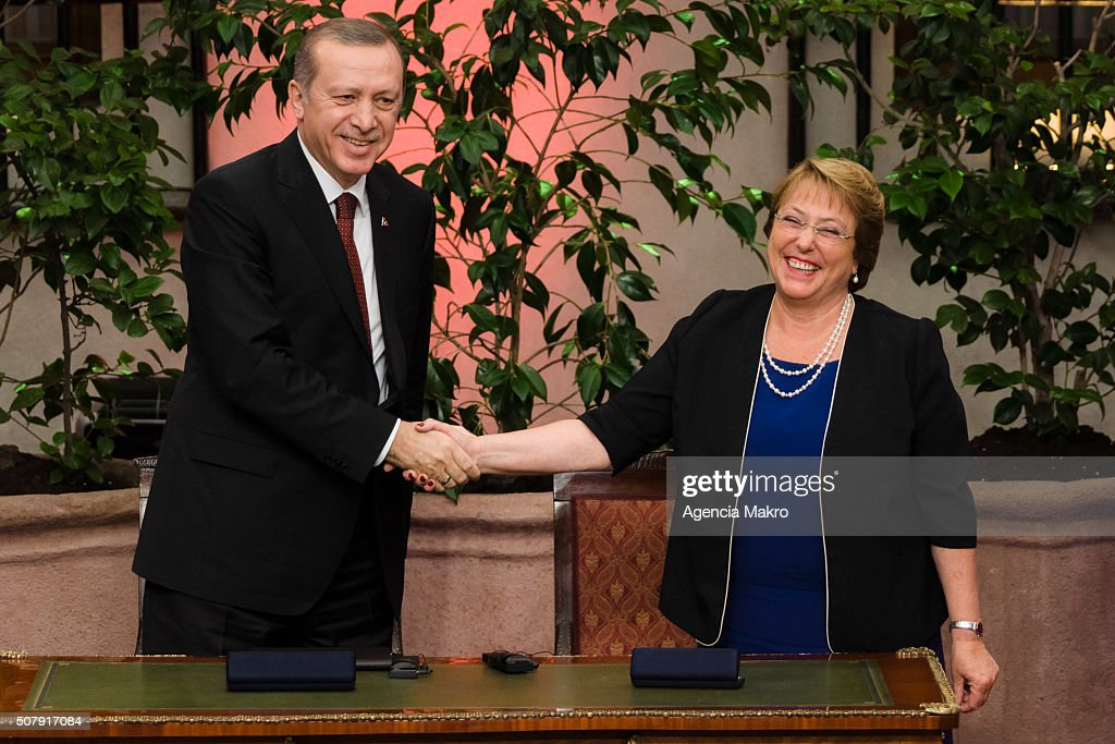 President of Chile Michelle Bachelet (L) and President of Turkey Recep Tayyip Erdogan(R) shake hands after signing a cooperation agreement between Chile and Turkey at Palacio de La Moneda on February 01, 2016 in Santiago, Chile.