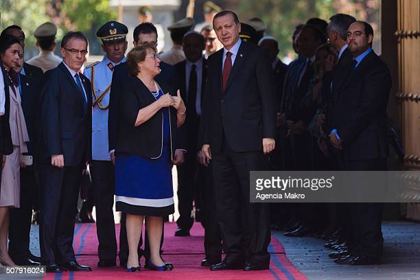 President of Chile Michelle Bachelet talks with President of Turkey Recep Tayyip Erdogan at Palacio de La Moneda on February 01 2016 in Santiago Chile
