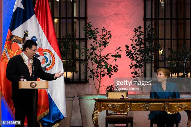 President of Chile Michelle Bachelet with the President of the Republic of Paraguay Horacio Cartes talk to the press in the Patio de Las Camelias of...