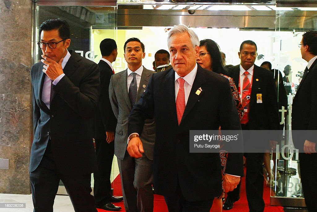 President of Chile Sebastian Pinera (C) arrives at the APEC CEO summit venue on October 6, 2013 in Nusa Dua, Indonesia.