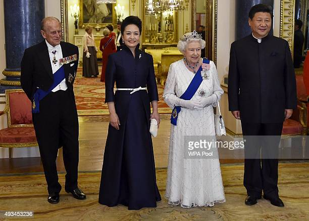 President of China Xi Jinping and his wife Peng Liyuan accompany Britain's Queen Elizabeth II and her husband Prince Philip Duke of Edinburgh as they...