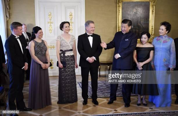 President of China Xi Jinping with his wife Peng Liyuan President of Finland Sauli Niinisto with his wife Jenni Haukio meet Finnish nordic skiers...