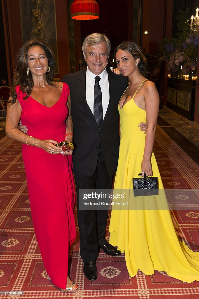 President of Christian Dior Couture <a gi-track='captionPersonalityLinkClicked' href=/galleries/search?phrase=Sidney+Toledano&family=editorial&specificpeople=758670 ng-click='$event.stopPropagation()'>Sidney Toledano</a> (C), his wife Katia (L) and their daughter Julia attend the Grand Bal Care in Deauville on August 24, 2013 in Deauville, France. Care France, the French branch of the humanitarian aid organization Care, was celebrating its 30th anniversary on Saturday.