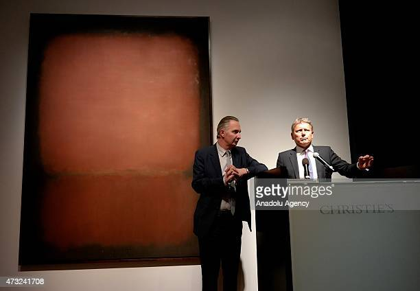 President of Christie's Jussi Pylkkanen leads an auction on a painting by abstract expressionist Mark Rothko that is sold for close to $82 million...