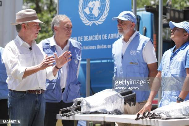 President of Colombia Juan Manuel Santos and Head of the UN Mission to Colombia Jean Arnault attend a ceremony to mark the handover of last container...
