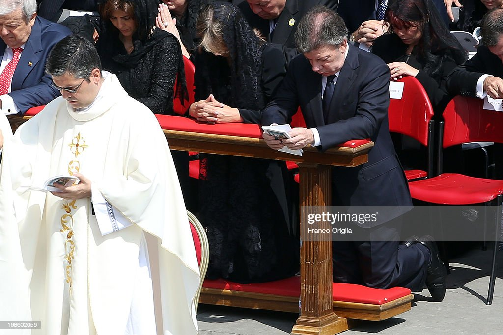 President of Colombia <a gi-track='captionPersonalityLinkClicked' href=/galleries/search?phrase=Juan+Manuel+Santos&family=editorial&specificpeople=974752 ng-click='$event.stopPropagation()'>Juan Manuel Santos</a> Calderon and his wife Maria Clemencia Rodriguez attend the canonization ceremony of first Colombian Saint in history Laura di Santa Caterina da Siena Montoya y Upegui during a Mass held by Pope Francis in St. Peter's Square on May 12, 2013 in Vatican City, Vatican. The pontiff today canonized over 800 new saints; Antonio Primaldo and his companions, martyrs of Otranto in Italy; first Colombian Saint in history Laura di Santa Caterina da Siena Montoya y Upegui, virgin and foundress; and the Mexican Maria Guadalupe Garcia Zavala, co-foundress.