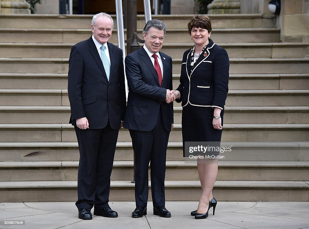 President of Colombia, Juan Manuel Santos (C) is greeted at Stormont Castle by Northern Ireland First Minister Arlene Foster (R) and Deputy First Minister Martin McGuinness (L) on November 3, 2016 in Belfast, Northern Ireland. Today's visit forms part of this week's state visit by Mr Santos to the UK. He is expected to pay tribute to Northern Ireland politicians and activists who helped end Colombia's 52-year conflict with left-wing rebels. President Santos won this year's Nobel Peace Prize for his part in securing the agreement. President Santos will hold talks with the first and deputy first ministers and the secretary of state and is expected to tell Arlene Foster and Martin McGuinness how his government learned from the Northern Ireland peace process.