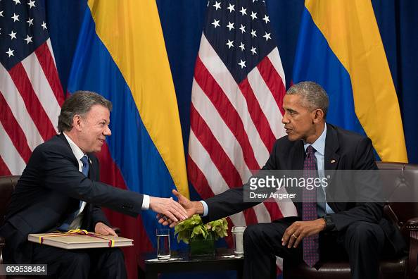 President of Colombia Juan Manuel Santos shakes hands with US President Barack Obama during a bilateral meeting at the Lotte New York Palace Hotel...