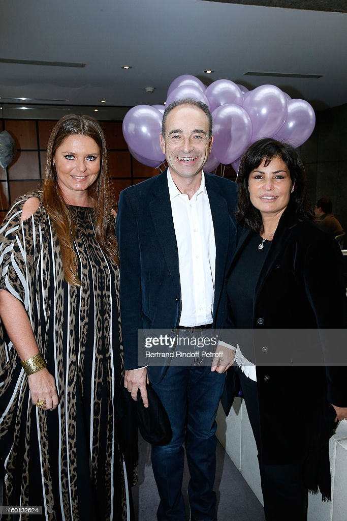 President of committee 'Reve d'enfants 2014' Karin Rudnicki-Schlumberger and Jean-Francois Cope with his wife Nadia attend the Matinee 'Reve d'enfants' with Opera 'Casse Noisette'. Organized by AROP at Opera Bastille on December 7, 2014 in Paris, France.