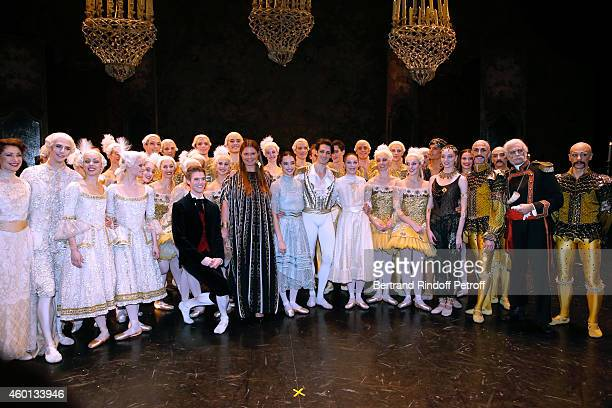 President of committee 'Reve d'enfants 2014' Karin RudnickiSchlumberger Star Dancers Mathieu Ganio and Dorothee Gilbert pose with the troup after the...