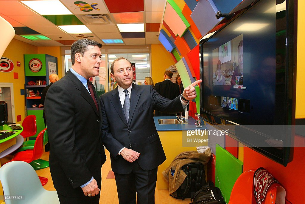 President of Companions in Courage Pat LaFontaine (L) and NHL Commissioner Gary Bettmen talk in front of the CISCO Systems Web Ex video conferencing screen in the Lion's Den during the Lion's Den 'Champions in Courage' North Carolina Chidren's Hospital Chapel Hill visit as part of 2011 NHL All-Star Weekend on January 28, 2011 in Raleigh, North Carolina.