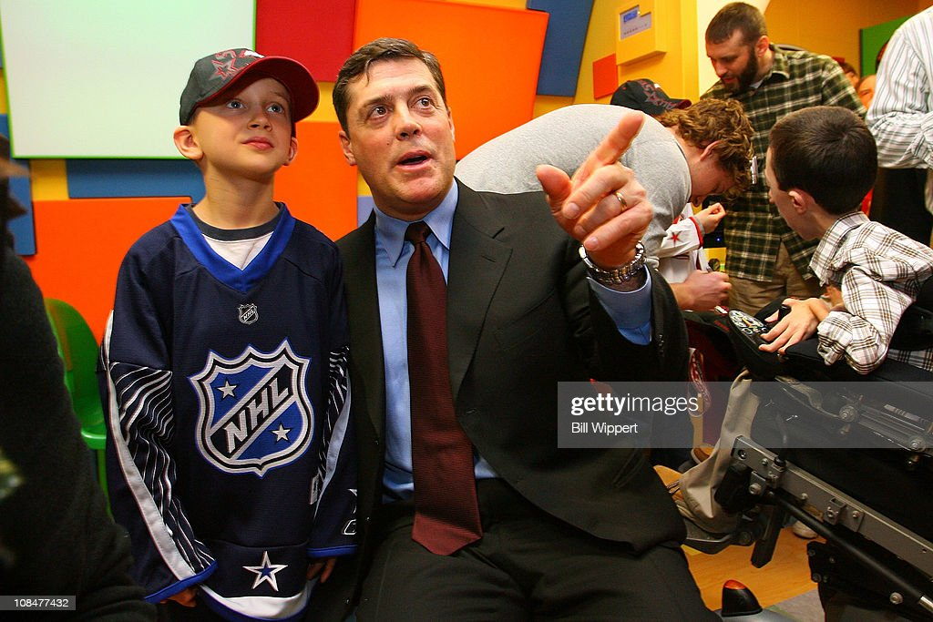 President of COmpanions in Courage Pat LaFontaine speaks with 8-year old Titus Gullion (whose brother is a patient at the hospital) during the Lion's Den 'Champions in Courage' North Carolina Chidren's Hospital Chapel Hill visit as part of 2011 NHL All-Star Weekend on January 28, 2011 in Raleigh, North Carolina.