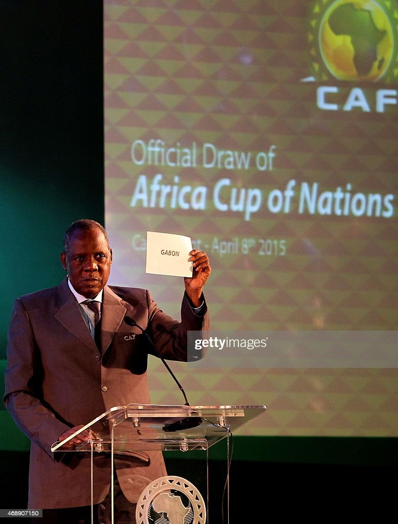President of Confederation of African Football Issa Hayatou shows up the name of Gabon after the country won the contest against Algeria and Ghana to...