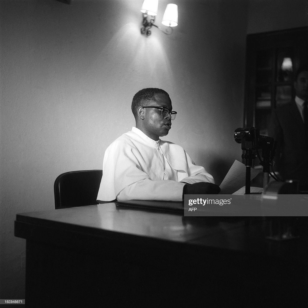 President of Congo abbot Fulbert Youlou adresses the radio during the night of the 13th and 14th August 1963 during violent riots and strikes asking...