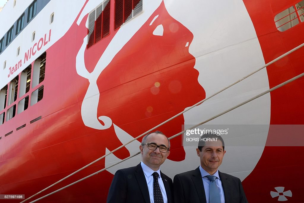 President of Corsica-Linea company Pascal Trojani and vice-president Pierre-Antoine Villanova (L) pose next to the Jean Nicoli vessel on May 3, 2016 in Marseille, southern France, during the new mediteranean shipping line presentation. / AFP / BORIS