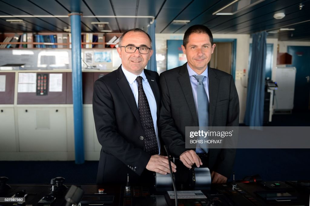 President of Corsica-Linea company Pascal Trojani and vice-president Pierre-Antoine Villanova (L) pose at the Jean Nicoli vessel's commander post on May 3, 2016 in Marseille, southern France, during the new mediteranean shipping line presentation. / AFP / BORIS