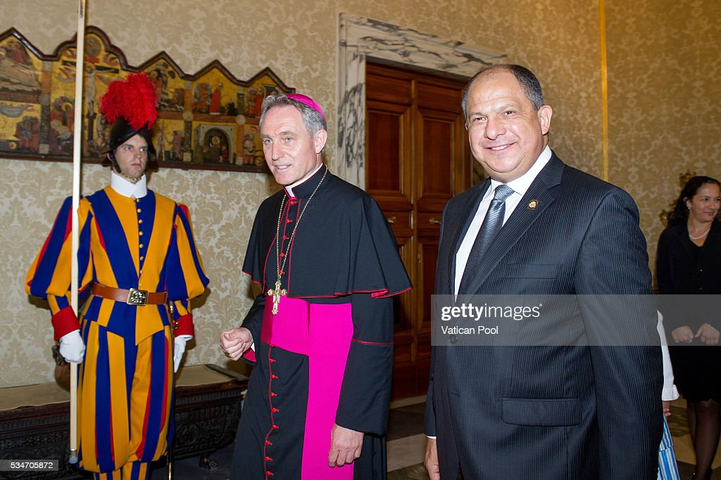 President of Costa Rica, Luis Guillermo Sols Rivera, flanked by Prefect of the Pontifical House Georg Ganswein, arrives at the Apostolic Palace for an audience with Pope Francis on May 27, 2016 in Vatican City, Vatican. The two leaders spoke about several themes of common interest, including the protection of human life, migration, and drug trafficking.