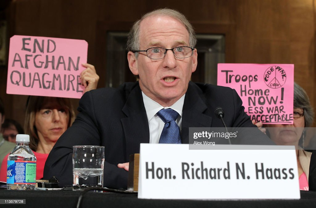 President of Council on Foreign Relations Richard Haass testifies as members of Code Pink protest during a hearing before the Senate Foreign...