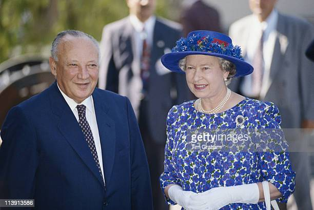 President of Cyprus Glafcos Clerides alongside Queen Elizabeth II wearing a blue and white dress with a blue hat during the British monarch's visit...