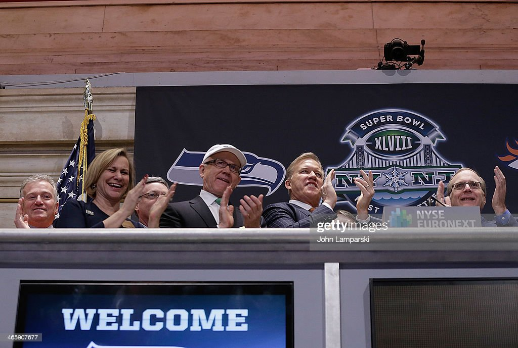 President of Denver Broncos Joe Ellis, Laurie Tisch, Co Owner of the NY Jets Woody Johnson, Executive VP of Football Operations Denver Broncos, John Elway, Owner of the Seattle Seahawks Paul Allen ring the opening bell at New York Stock Exchange on January 30, 2014 in New York City.