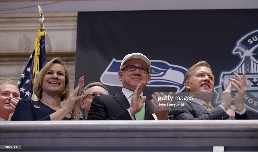 President of Denver Broncos Joe Ellis, Laurie Tisch, Co Owner of the NY Jets <a gi-track='captionPersonalityLinkClicked' href=/galleries/search?phrase=Woody+Johnson&family=editorial&specificpeople=748966 ng-click='$event.stopPropagation()'>Woody Johnson</a> and Executive VP of Football Operations Denver Broncos, <a gi-track='captionPersonalityLinkClicked' href=/galleries/search?phrase=John+Elway&family=editorial&specificpeople=204173 ng-click='$event.stopPropagation()'>John Elway</a> ring the opening bell at New York Stock Exchange on January 30, 2014 in New York City.