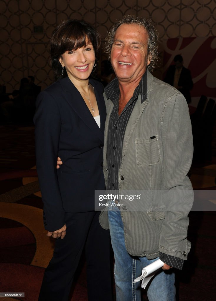 President of Dick Clark Productions Orly Adelson (L) and AMA show produer Larry Klein pose during the 40th Anniversary American Music Awards nominations press conference at the JW Marriott Los Angeles at L.A. LIVE on October 9, 2012 in Los Angeles, California.