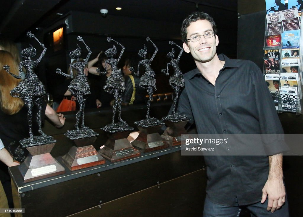 President of Dualtone Music Group, Paul Roper, poses for photos with five Libera awards during 2nd Annual Libera Awards at Highline Ballroom on June 20, 2013 in New York City.