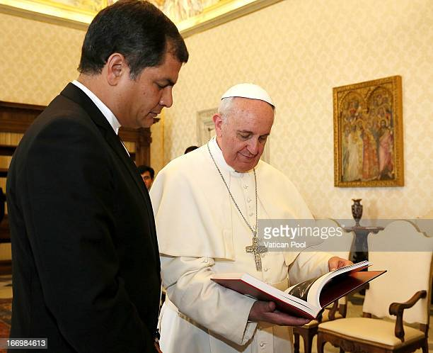 President of Ecuador Rafael Correa exchanges gifts with Pope Francis at his private library on April 19 2013 in Vatican City Vatican The President of...