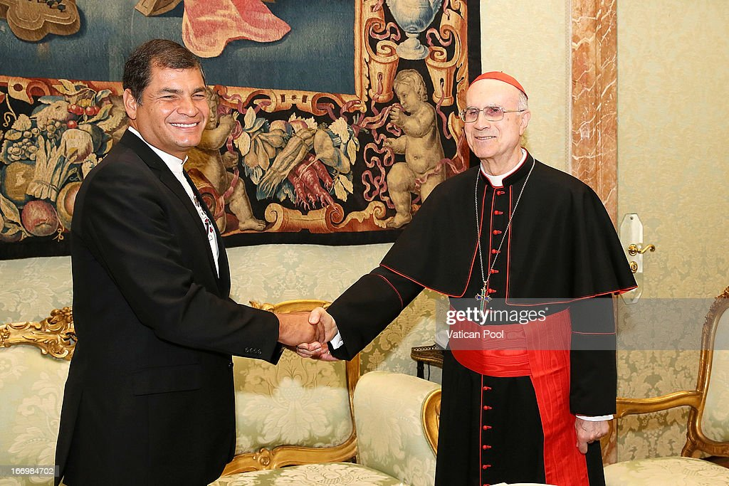 President of Ecuador <a gi-track='captionPersonalityLinkClicked' href=/galleries/search?phrase=Rafael+Correa&family=editorial&specificpeople=2294079 ng-click='$event.stopPropagation()'>Rafael Correa</a> meets with Vatican secretary of State Cardinal <a gi-track='captionPersonalityLinkClicked' href=/galleries/search?phrase=Tarcisio+Bertone&family=editorial&specificpeople=549351 ng-click='$event.stopPropagation()'>Tarcisio Bertone</a> at the private library of Pope Francis on April 19, 2013 in Vatican City, Vatican. The President of Ecuador met Pope Francis for talks about his country and the church's contribution to aspects of Ecuador's social challenges that lie ahead.