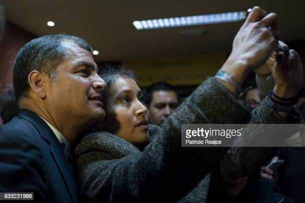 President of Ecuador Rafael Correa takes a selfie with a woman during the conference 'Economy for Development Ecuador Case' at the Complutense...