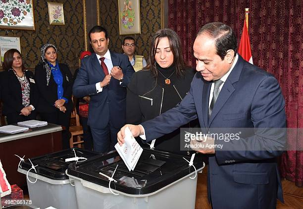 President of Egypt Abdel Fattah elSisi casts his vote during the second round of the parliamentary elections at a polling station in Cairo Egypt on...