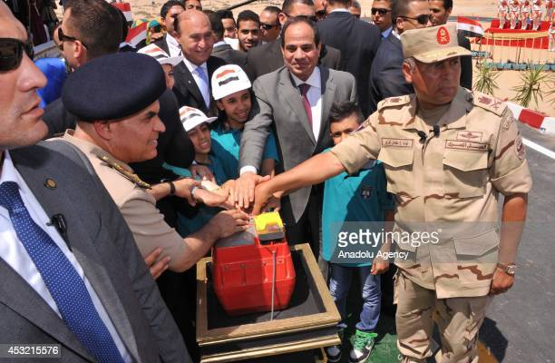 President of Egypt Abdel Fattah elSisi children and member of Egyptian army inaugurate the digging of a new section of the Suez Canal in Ismailia...