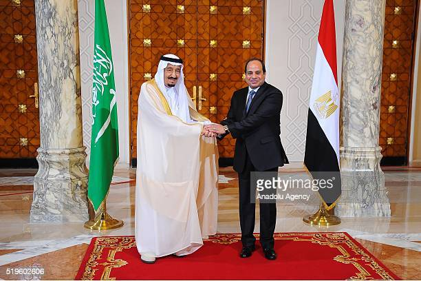 President of Egypt Abdel Fattah elSisi welcomes King Salman bin Abdulaziz Al Saud of Saudi Arabia at the Egyptian Presidential Palace in Cairo Egypt...