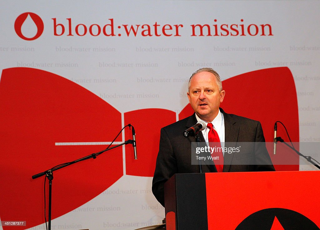 Water Mission Mike Hamilton speaks at the Red Tie Gala Hosted by Blood:Water Mission and sponsored by Noodle & Boo at Hutton Hotel on November 21, 2013 in Nashville, Tennessee.