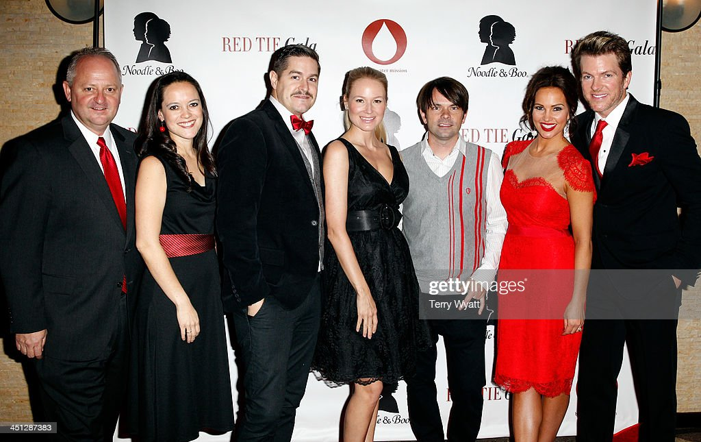 Water Mission Mike Hamiton, Founder and President of Blood:Water Mission Jena Nardella, Dan Haseltine of Jars of Clay, Singer/songwriter Jewel, Charlie Lowell of Jars of Clay, model Tiffany Fallon, and Joe Don Rooney of Rascall Flatts attend the Red Tie Gala Hosted by Blood:Water Mission and sponsored by Noodle & Boo at Hutton Hotel on November 21, 2013 in Nashville, Tennessee.
