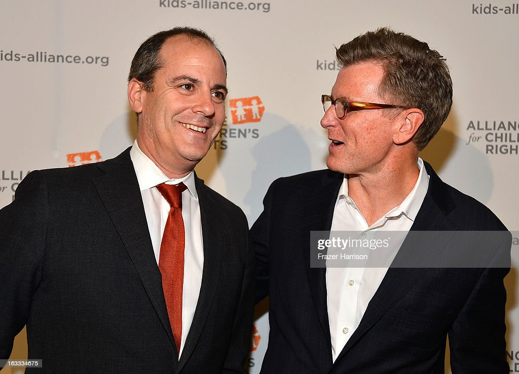 President of entertainment at Showtime David Nevins and Fox entertainment chairman <a gi-track='captionPersonalityLinkClicked' href=/galleries/search?phrase=Kevin+Reilly&family=editorial&specificpeople=224700 ng-click='$event.stopPropagation()'>Kevin Reilly</a> arrives at The Alliance For Children's Rights' 21st Annual Dinner at The Beverly Hilton Hotel on March 7, 2013 in Beverly Hills, California.