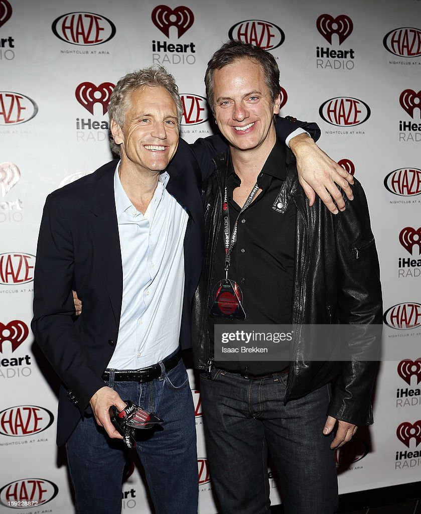 President of Entertainment Enterprises at Clear Channel John Sykes (L) and Tom Poleman President of National Programing Platforms at Clear Channel Media and Entertainment arrive at the iHeartRadio CES exclusive party featuring a live performance by Ke$ha at Haze Nightclub at the Aria Resort & Casino at CityCenter on January 9, 2013 in Las Vegas, Nevada.