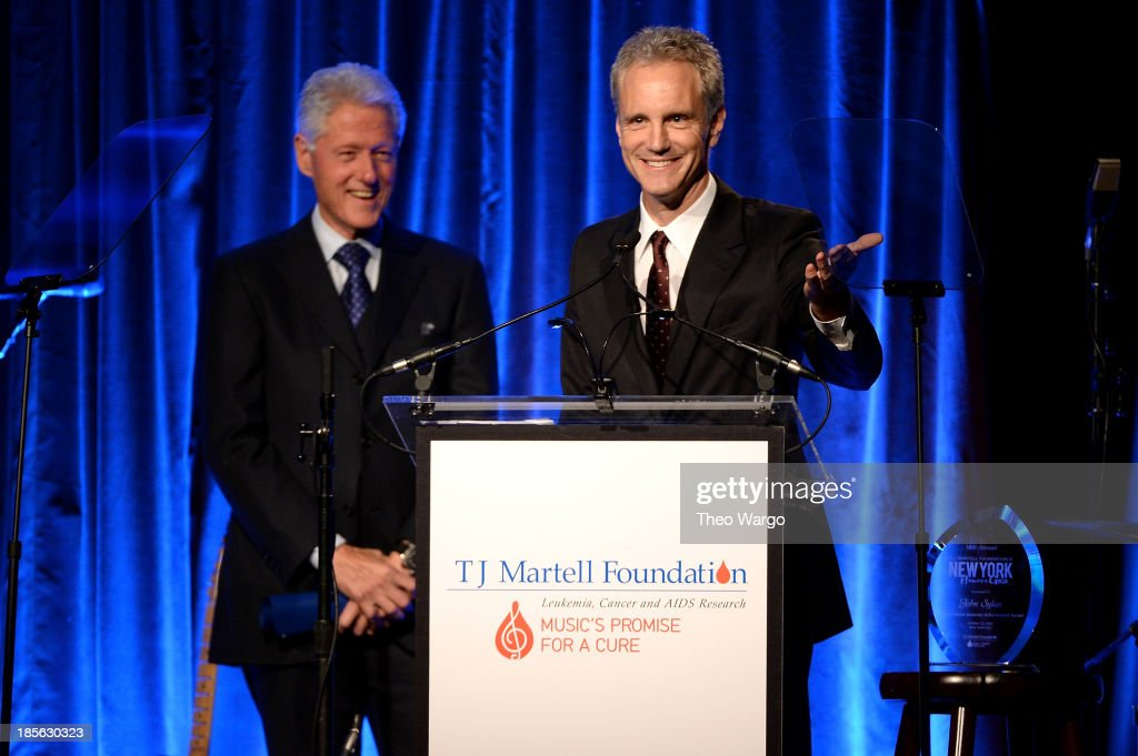 President of Entertainment Enterprises at Clear Channel John Sykes accepts the Lifetime Music Industry Award onstage with President Bill Clinton at...