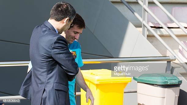 President of FC Barcelona Josep Maria Bartomeu greets Lionel Messi during the training session at Ciutat Esportiva on April 14 2014 in Barcelona Spain