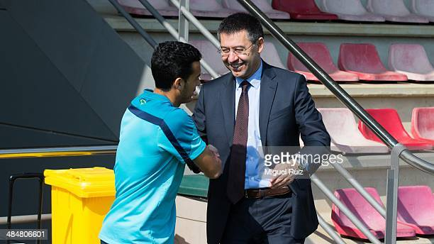 President of FC Barcelona Josep Maria Bartomeu greets Pedro Rodriguez during the training session at Ciutat Esportiva on April 14 2014 in Barcelona...