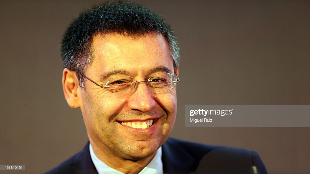 President of FC Barcelona <a gi-track='captionPersonalityLinkClicked' href=/galleries/search?phrase=Josep+Maria+Bartomeu&family=editorial&specificpeople=8048308 ng-click='$event.stopPropagation()'>Josep Maria Bartomeu</a> smiles during the farewell press conference as Puyol leaves FC Barcelona at the Auditorium 1899 on May 15, 2014 in Barcelona, Spain.
