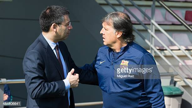 President of FC Barcelona Josep Maria Bartomeu speaks with Head coach of FC Barcelona Gerardo Tata Martino during the training session at Ciutat...
