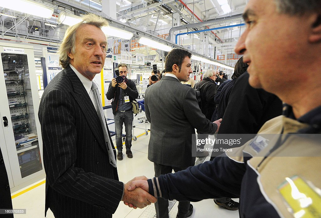 President of Ferrari Luca Cordero di Montezemolo greets workers during the unveiling of the new Maserati plant in Grugliasco, which has been dedicated to Gianni Agnelli on January 30, 2013 in Turin, Italy. The new plant near the company's headquarters in Turin will produce Maserati's new model of luxury saloon cars, the Quattroporte.