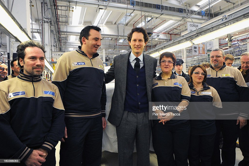 President of FIAT <a gi-track='captionPersonalityLinkClicked' href=/galleries/search?phrase=John+Elkann&family=editorial&specificpeople=571803 ng-click='$event.stopPropagation()'>John Elkann</a>, poses with the workers during the unveiling of the Maserati Plant in Grugliasco dedicated to Gianni Agnelli on January 30, 2013 in Turin, Italy. The new plant near the company's headquarters in Turin will produce Maserati's new model of luxury saloon cars, the Quattroporte.
